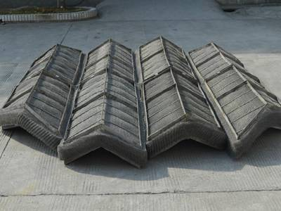 There is a wave type wire mesh demister placed on the ground.